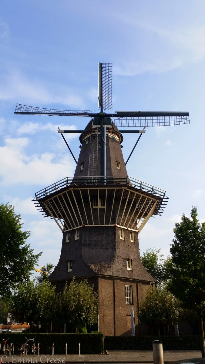 Amsterdam Canals Tulips Windmills And Clogs