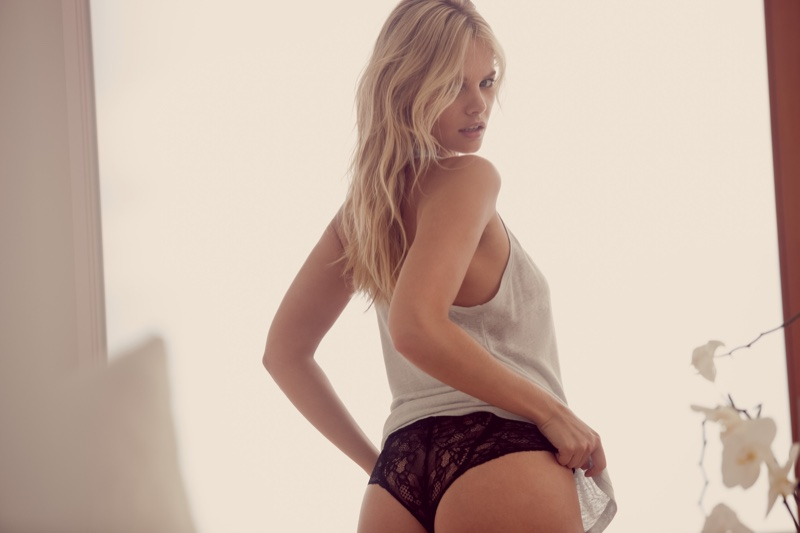 Stripping down, Marloes Horst wears Eberjey tank top and lace bikini bottoms