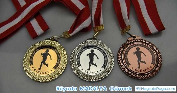 Rüyada Madalyanın Görülmesi rüyada altın madalyon görmek rüyada gümüş madalya kazanmak rüyada boynuna madalya takmak rüyada madalyon bulmak rüyada kupa kazanmak rüyada plaket aldığını görmek rüyada ödül kazanmak rüyada ödül töreni görmek