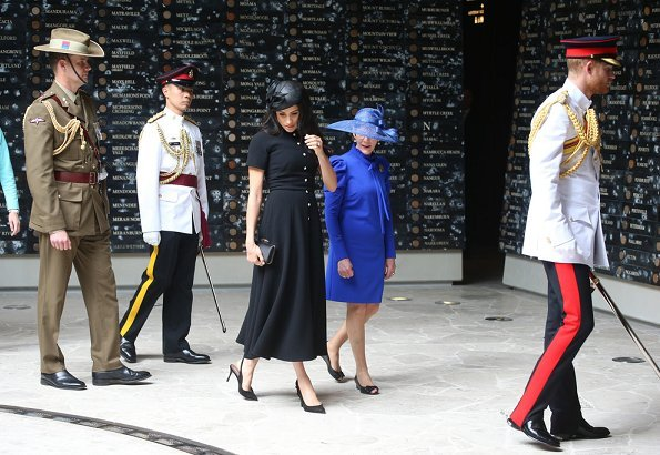 Meghan Markle, wearing an elegant Emilia Wickstead wool crepe dress and Philip Treacy hat. Aquazzura Deneuve pow pointy poe pump