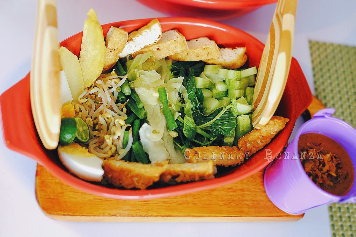 Gado-Gado - traditional Indonesian steamed vegetables (string beans, bean sprouts, potato, water spinach, etc), tofu and tempeh served with sweet and spicy peanut sauce and fried shallots.