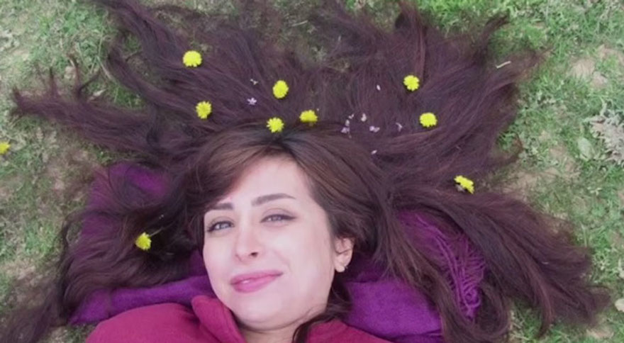 "Iranian Women Are Posting Pics With Their Hair Flying Free In Protest Of Strict Hijab Laws - ""Let It Go"""