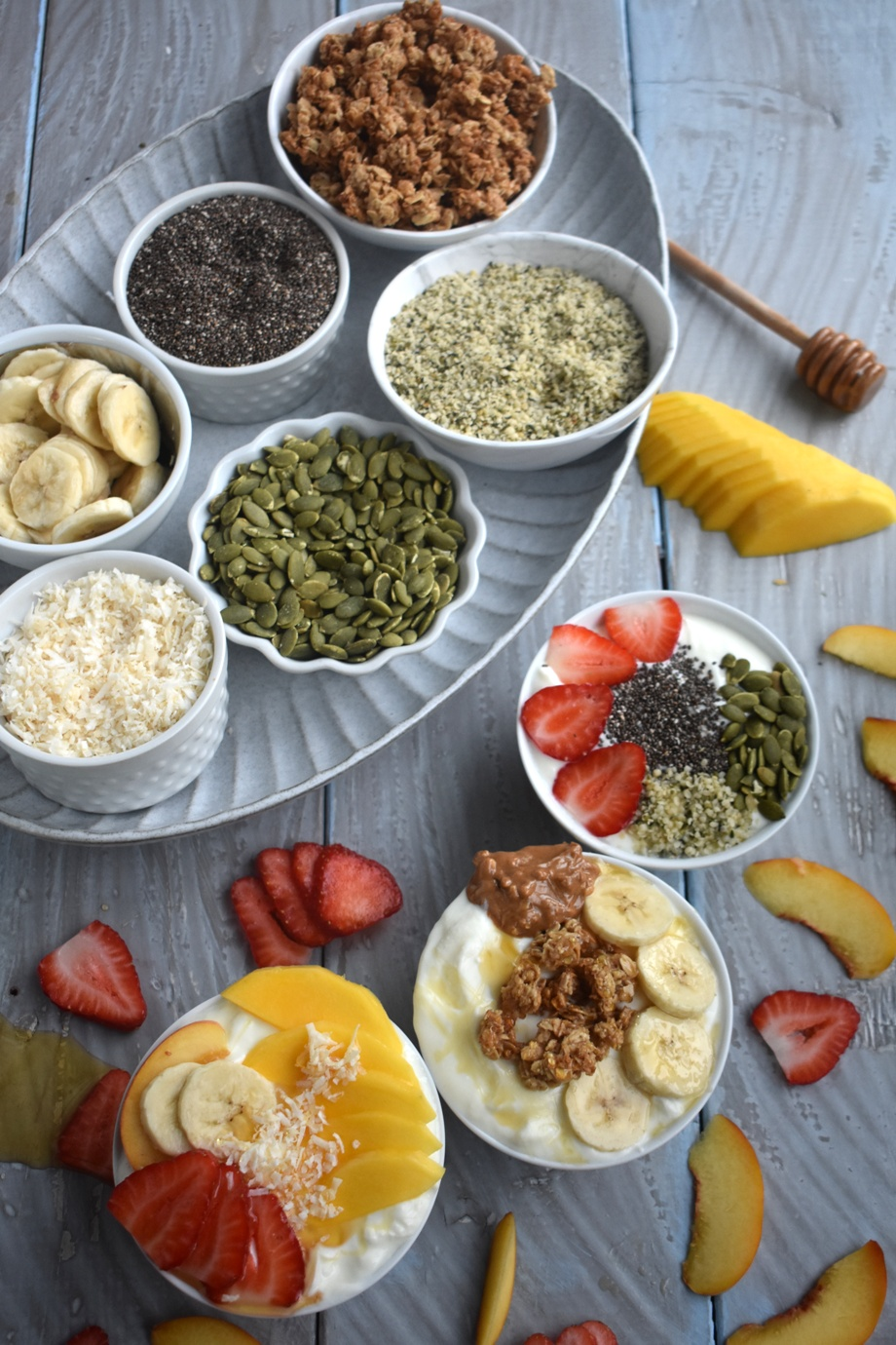 Build Your Own Yogurt Bowl Bar has tons of toppings for yogurt including fruit, honey, nuts, seeds, cereal, granola and more for a fun breakfast that the whole family will love and that is great for entertaining! www.nutritionistreviews.com