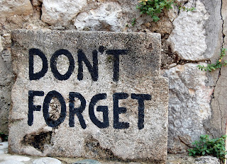 "Words ""don't forget"" on stone"