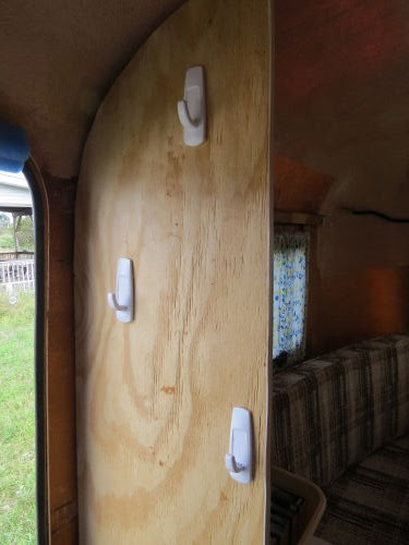 wall with hooks in a partially finished fiberglass trailer