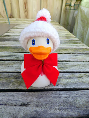 Plastic Duck with hearts in crocheted santa hat and giant red bow