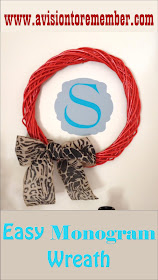 How to make a large wreath into a bright wall art with a little monogram.  Simple, Huge Impact