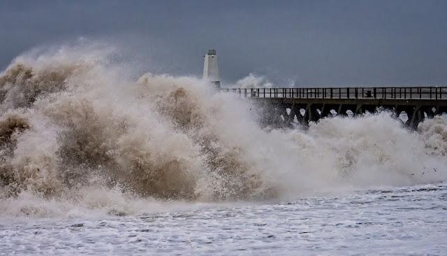Photo of giant waves crashing onto the shore at Maryport during Storm Erik