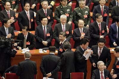 Xi, center, at the opening of the Communist Party Congress last week