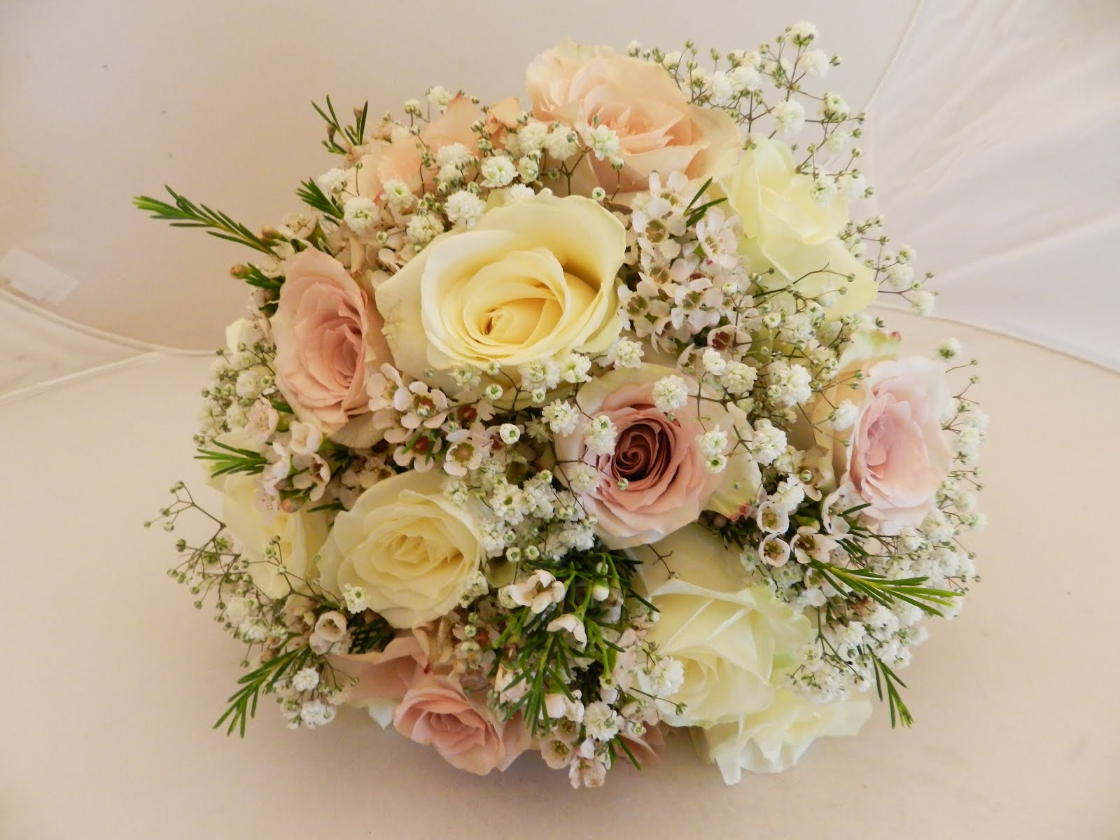 Sandras flower studio pretty ivory and blush wedding flowers the brides bouquet was a hand tie posy of avalanche roses teamed with quicksand roses gyp and pink wax flower izmirmasajfo