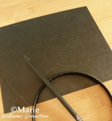 Black card and pencil to make a costume headband