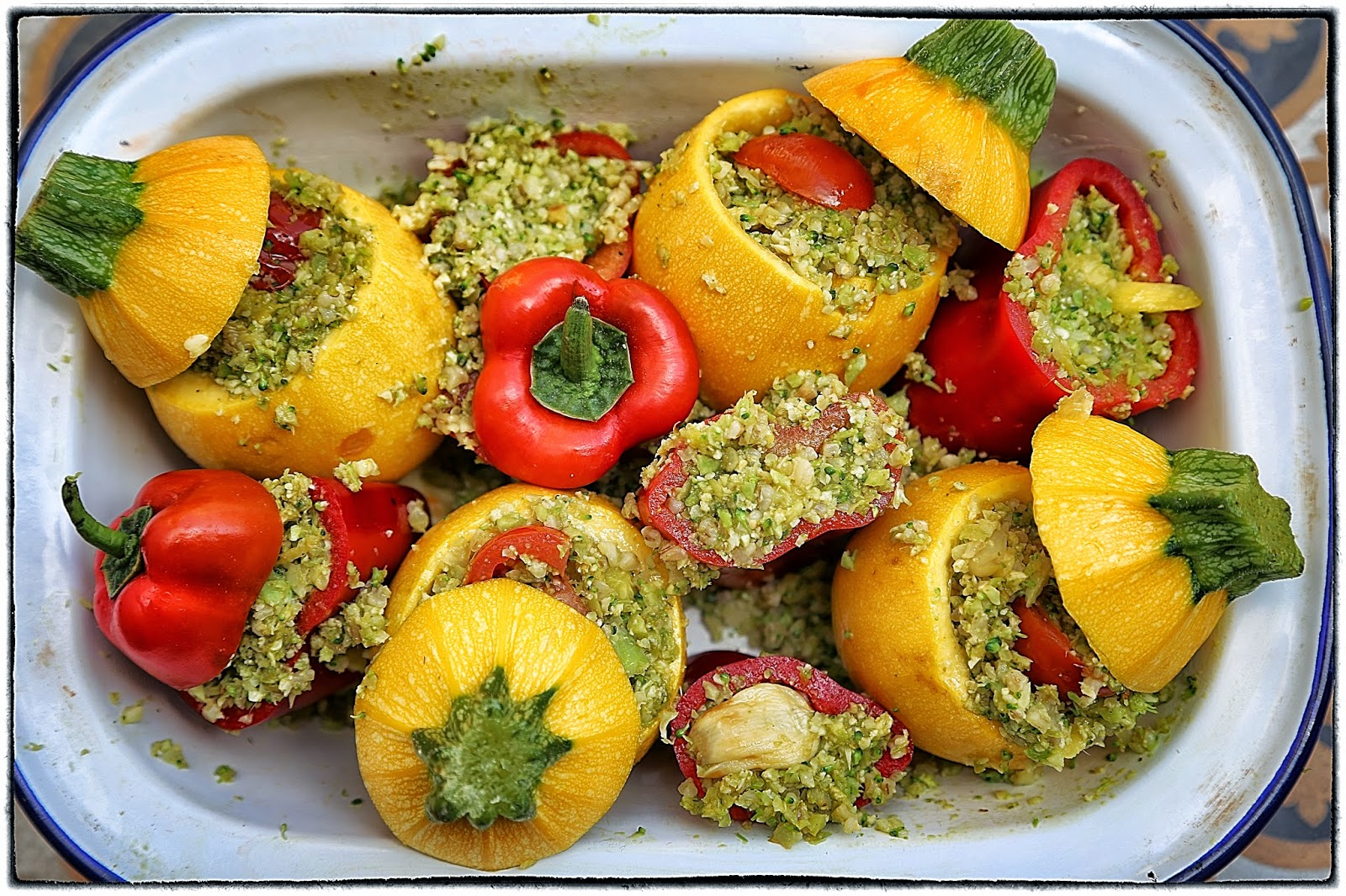 Stuffed yellow courgette and red pepper bake
