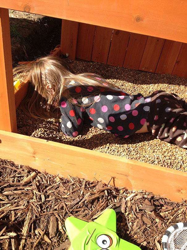 15+ Hilarious Pics That Prove Kids Can Sleep Anywhere - Napping In A Sand Box