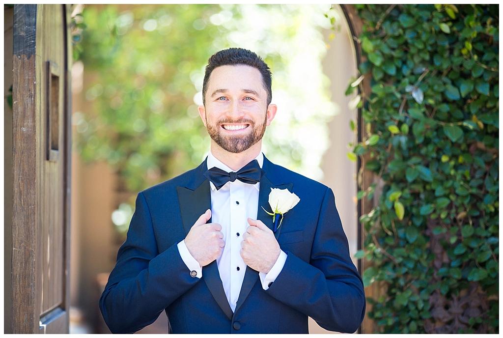groom in navy blue suit at the montelucia