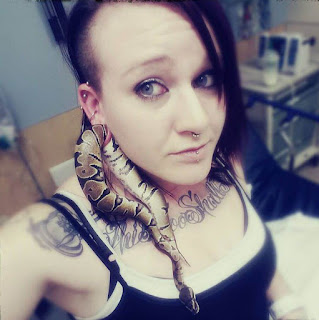 Pet python stuck in woman's ear