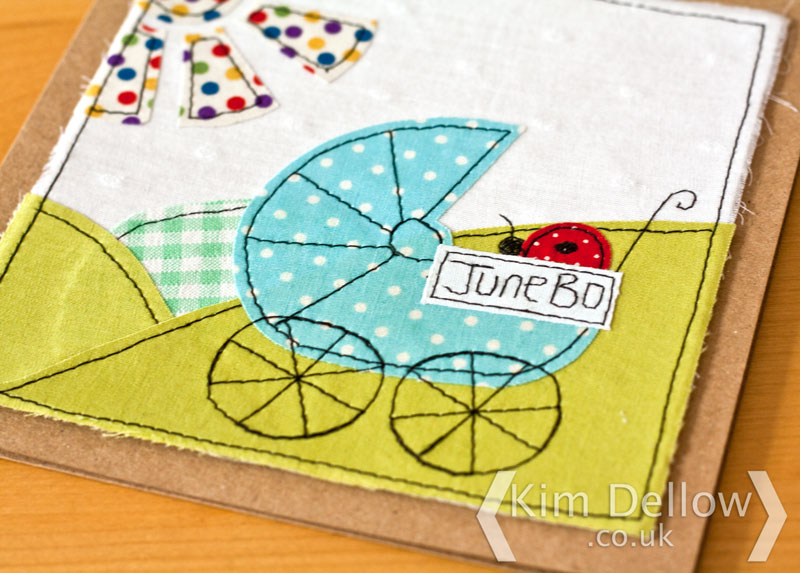 Close up of the faux free-motion machine embroidery new baby card