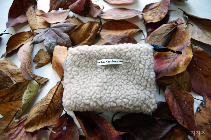 2e85d0574799 Small cosmetic pouch made of faux fur makeup bag mini wallet.