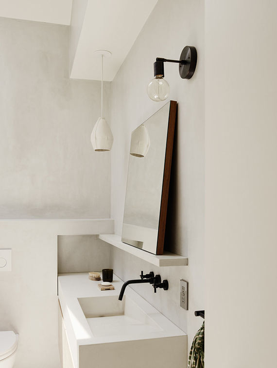 Gorgeous concrete bathroom with skylight by General Assembly