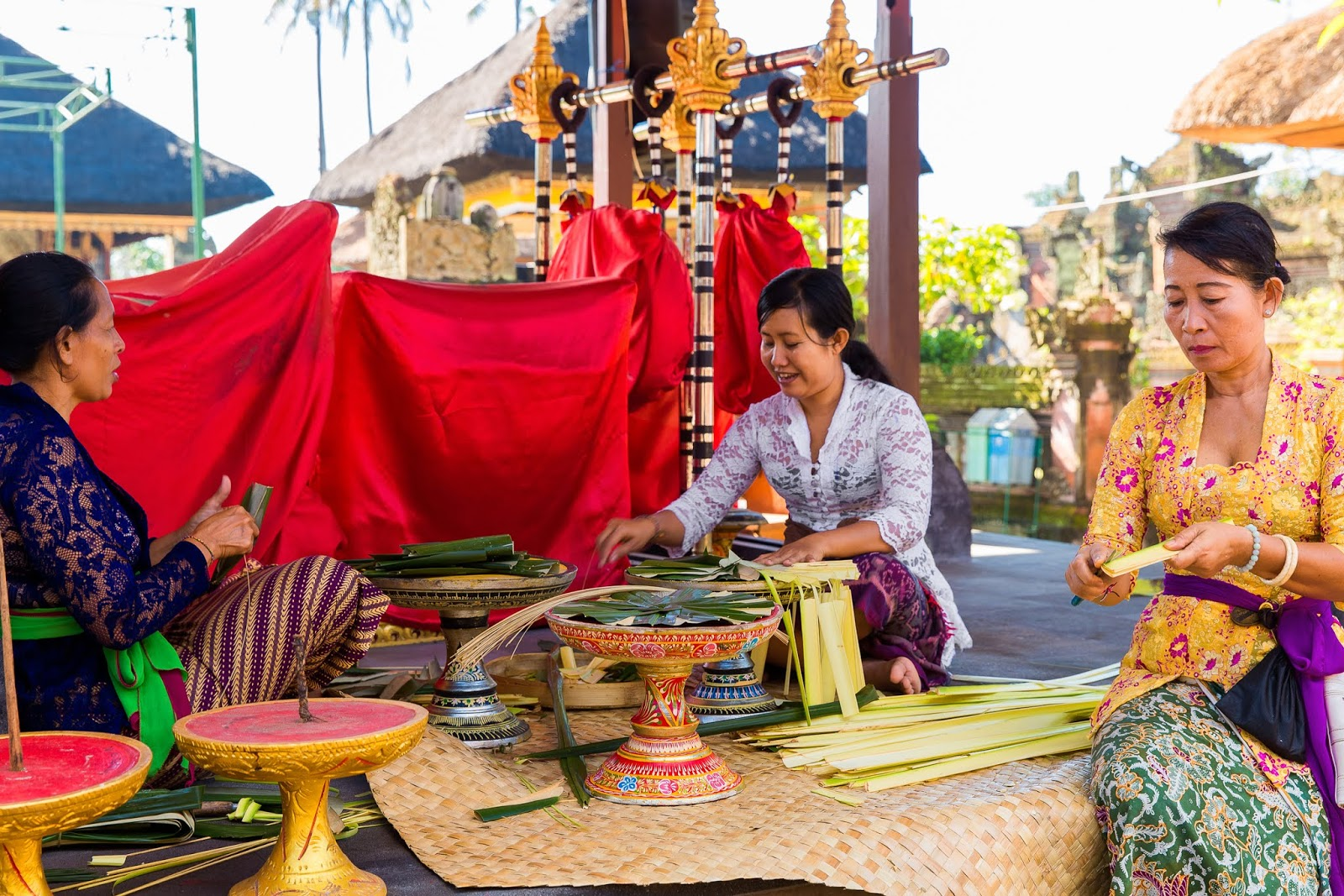 Balinese women make decorations for the temple