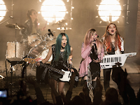 jem holograms movie concert scene costumes music dyed hair keyboard