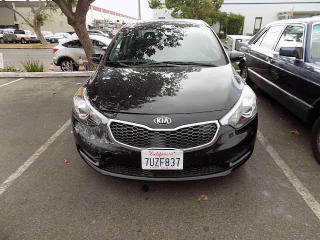 2015 Kia Forte before auto body repairs at Almost Everything Auto Body.