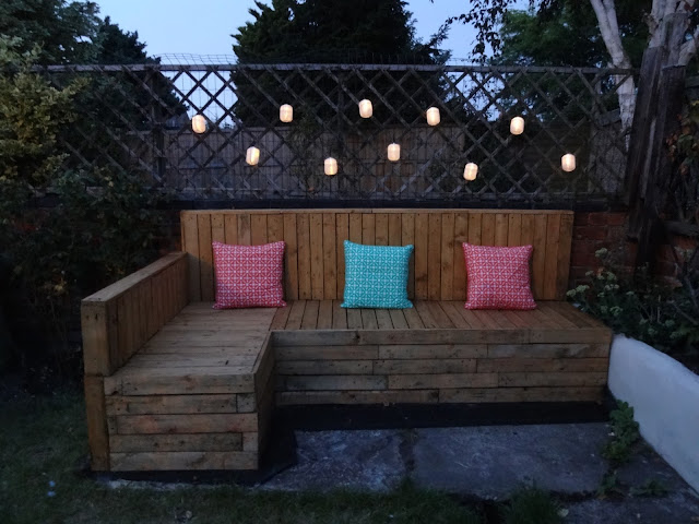 Pallet Seating at Night with Fairy Lights