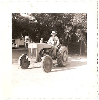 man and child on tractor circa 1930s or 1940s in southern California