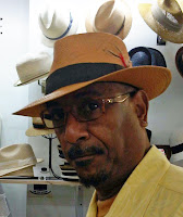 Honey colored panama hat from The Hat House worn by gentleman