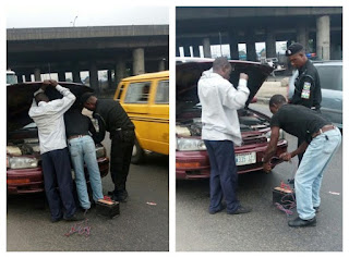 For real? Nigerian Policeman assists a motorist in fixing his car ?
