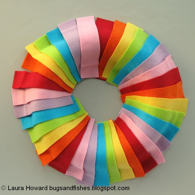 arranging the rainbow felt on the wreath base