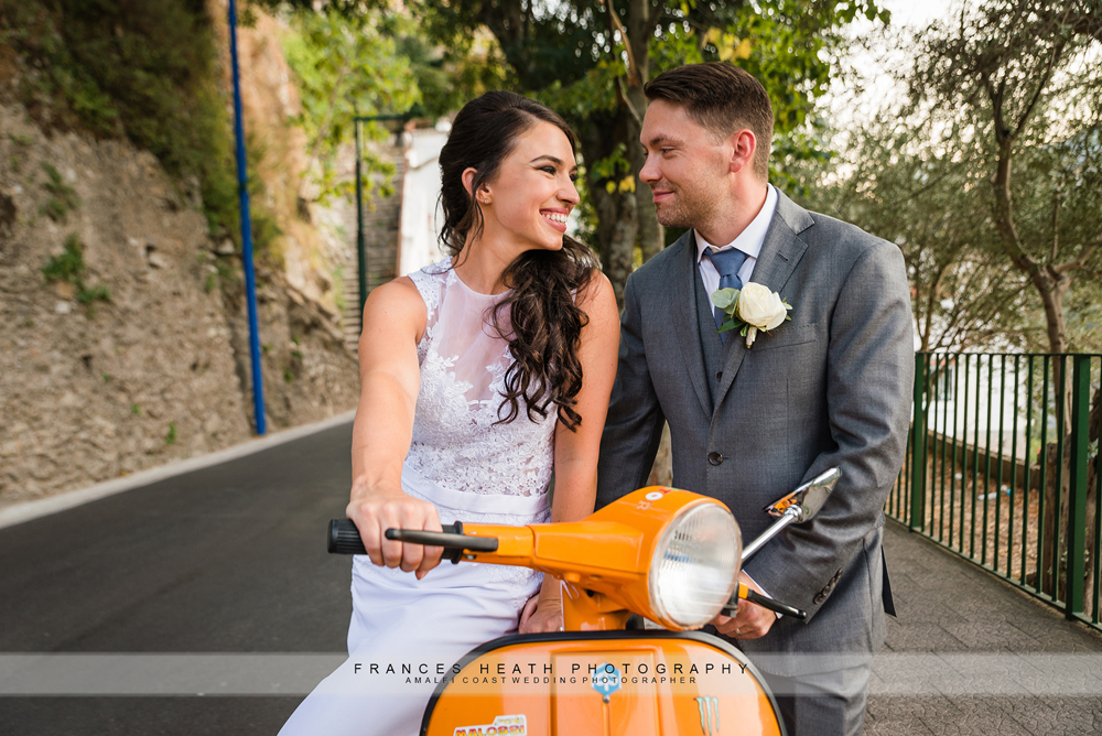 Bride and groom on vespa