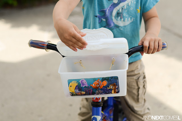 How to turn a plastic wipes container into an easy DIY upcycled bike basket for kids from And Next Comes L