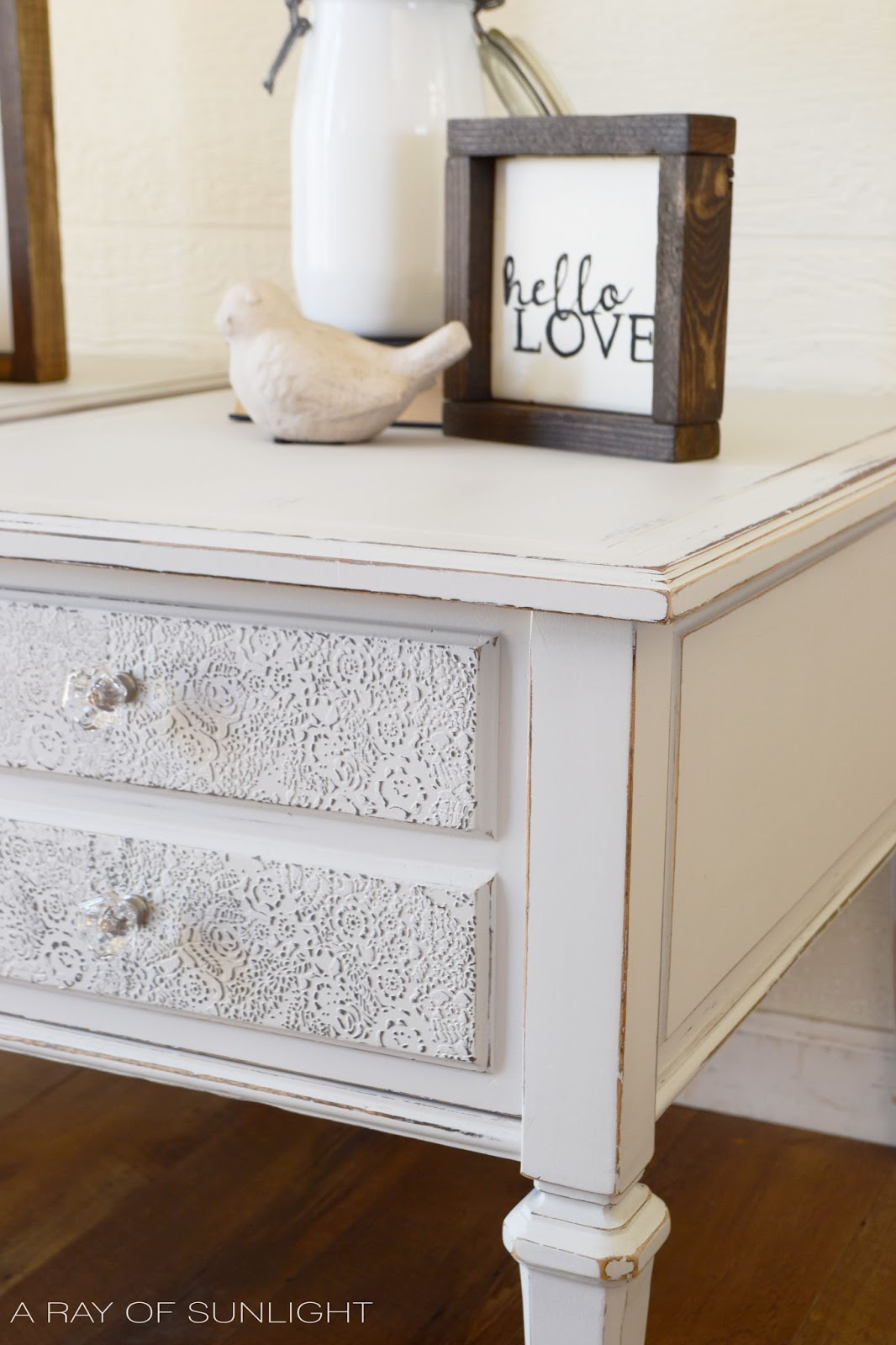 Get this look! The Light Gray End Tables with a Textured Stencil on the Drawer fronts and clear knobs. by A Ray of Sunlight This is the perfect neutral gray!