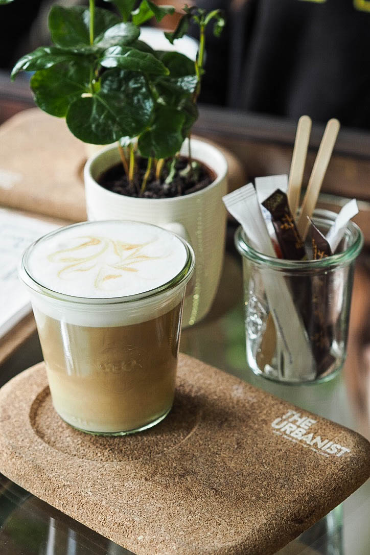 Latte in glass tumbler