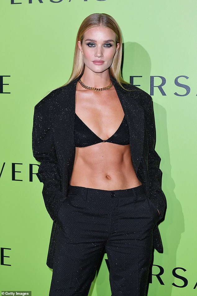 Rosie Huntington-Whiteley flaunts her washboard abs in a sparkly bra (Pictures)