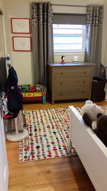 Perfect boy's super hero room, not too over-done. Features custom made Marvel Avengers quilt by Sew at Home Mummy. Super cool boys room rug! would hide the stains. Custom IKEA hack curtains, looks easy - add panel to top of blackouts.