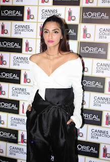 Sonam Kapoor in black and white outfit by Diogo Miranda at LOreals Cannes media interaction