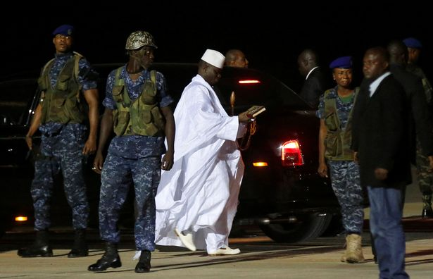 A-security-officer-of-former-Gambian-President-Yahya-Jammeh-cries-as-he-arrives-at-the-airport-befor