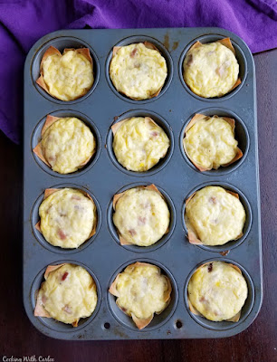 baked mini ham and cheese quiche in cupcake tin fresh from oven