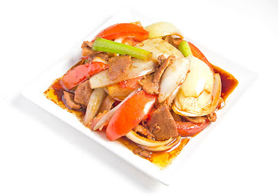 Chinese food - Pork stir-fried with onion and tomato
