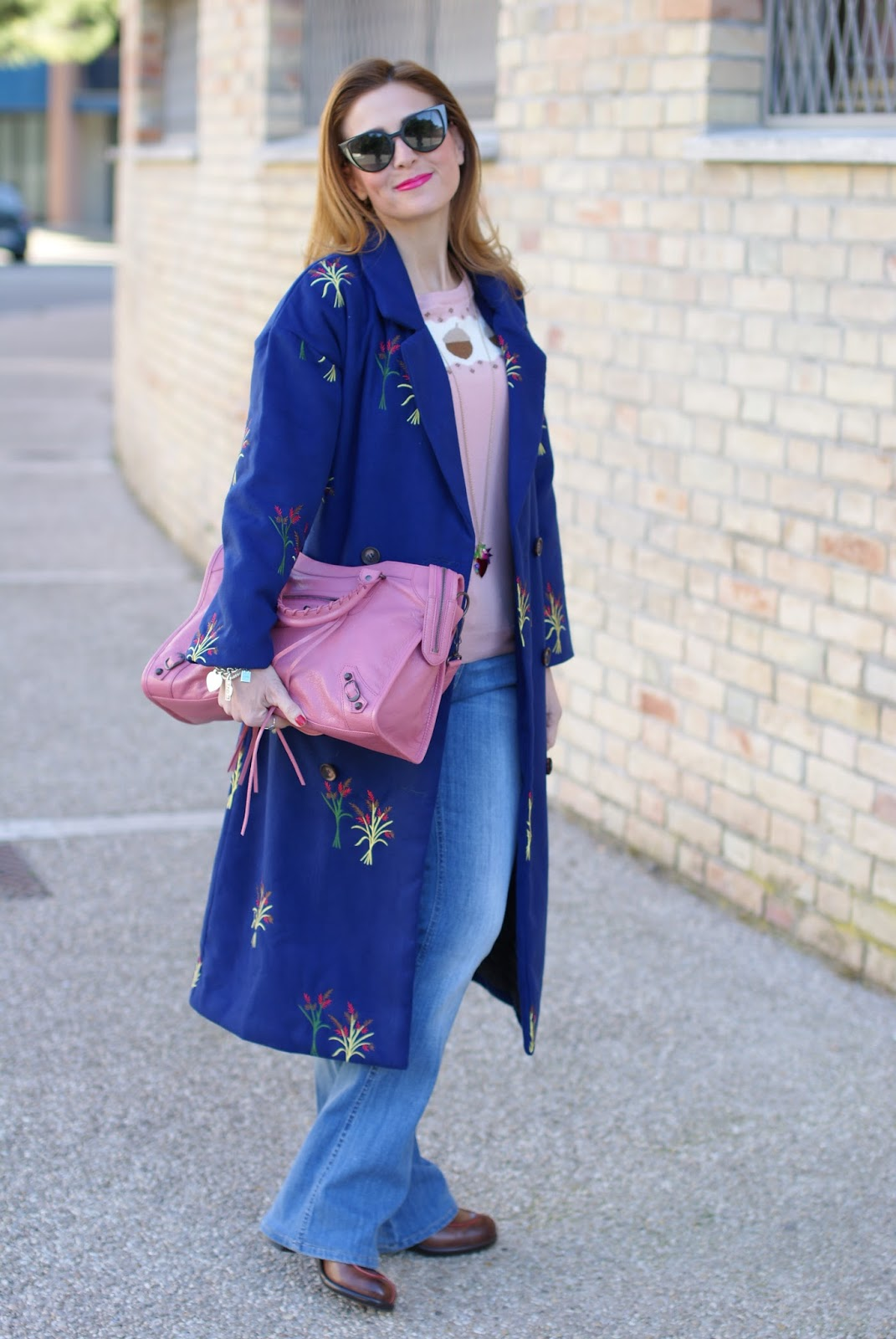 How to wear flare denim pants, a 70's inspired outfit with floral embroidered Zaful coat on Fashion and Cookies fashion blog, fashion blogger style