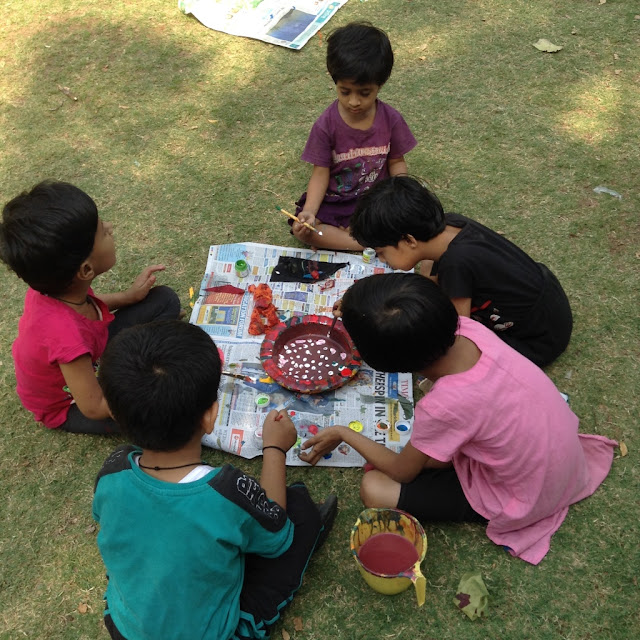 Kids paint earthen pots at their Holi celebrations - 2 ( event organised by Indiaart Gallery and Suyog Mitra Mandal )