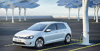 A Volkswagen e-Golf charges in a parking lot. Some analysts worry that the terms of Volkswagen AG's settlement — which call for the carmaker to inject $2 billion into the electric vehicle market — will give VW a leg up on its competition. (Photo Credit: Volkswagen) Click to Enlarge.