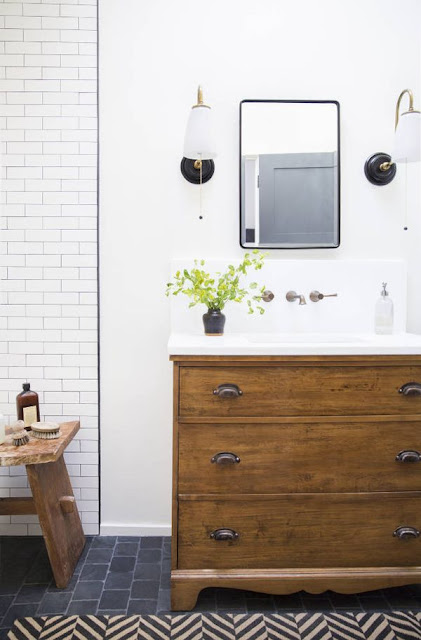 White bathroom with wood tone vanity