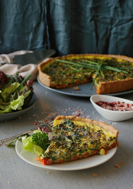 Tart with spelt flour pastry, organic spring vegetables and sun dried tomato pesto.