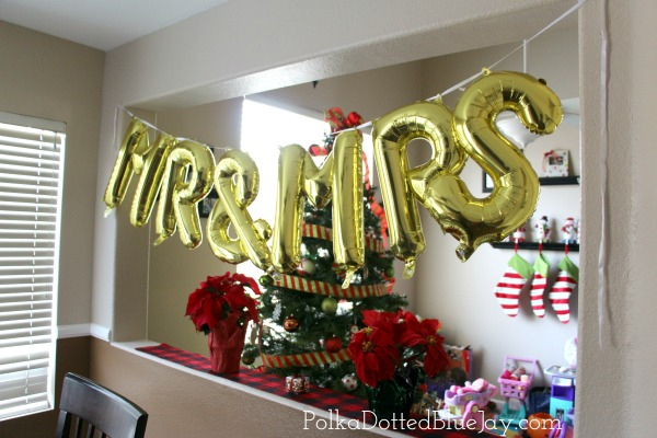 Plan a surprise Buffalo Plaid and Poinsettia Bridal Shower with a fun Hot Cocoa Bar