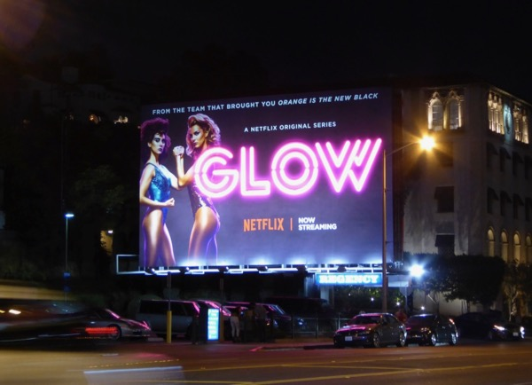 GLOW neon sign billboard installation Sunset Strip