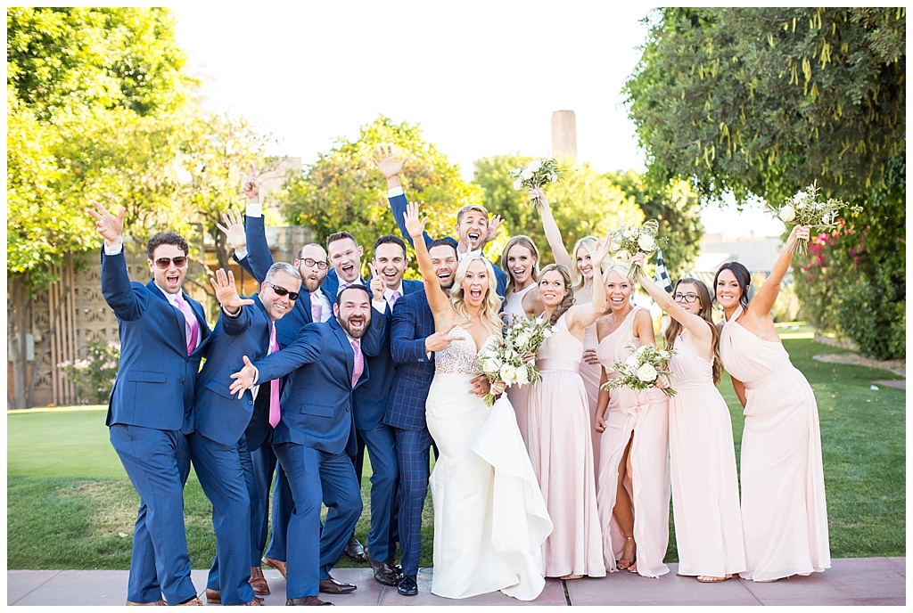 wedding party celebrating in navy and blush