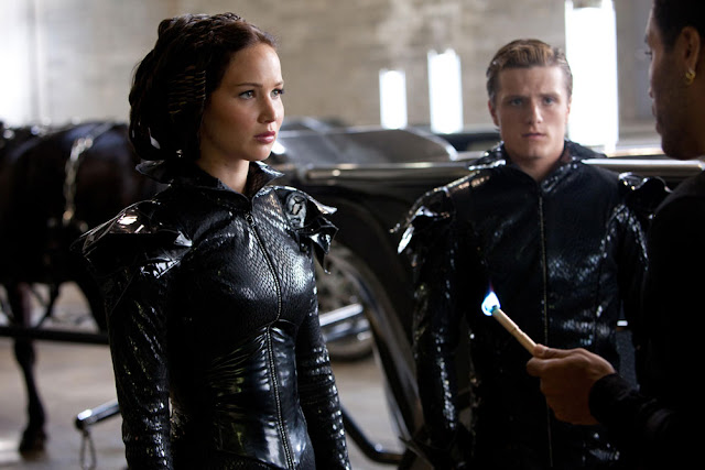 The Hunger Games Fashion and costumes - Katniss and Peeta fire dress for the Tribute Parade