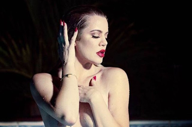 (Video) Khloe Kardashian bares ALL in raunchy naked shoot as she covers her famous curves in glitter